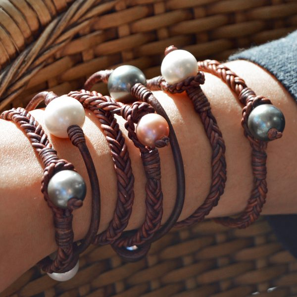 Collection of Vincent Peach bracelets featuring leather and braided leather with freshwater or tahitian pearls