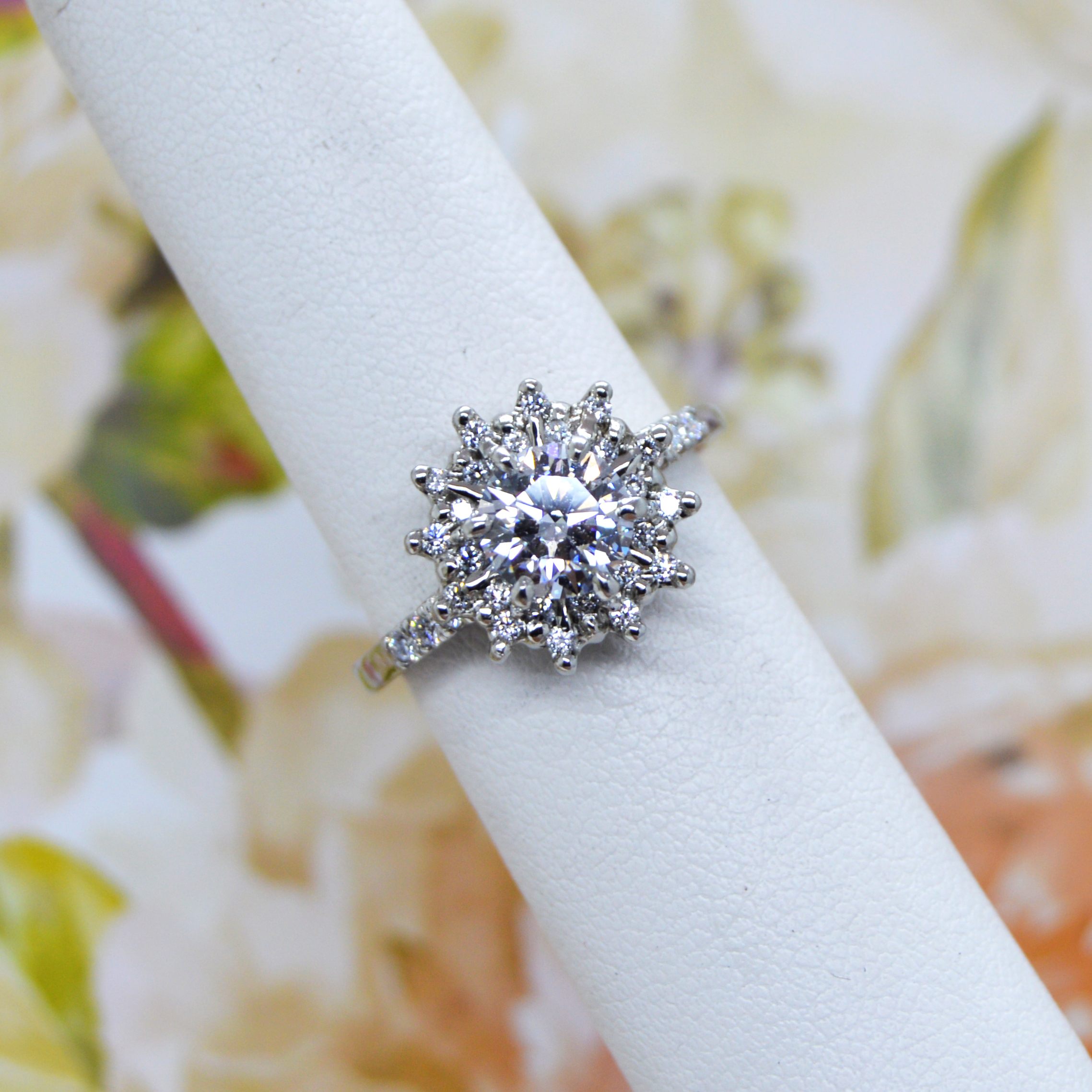 Prong set engagement ring with halo and accent diamonds designed by Morgan's Treasure