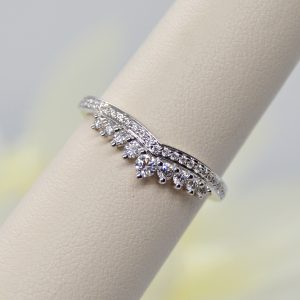 14k white gold ring with v shape shadow band for wedding band, graduated diamonds prong set designed by Allison Kaufman
