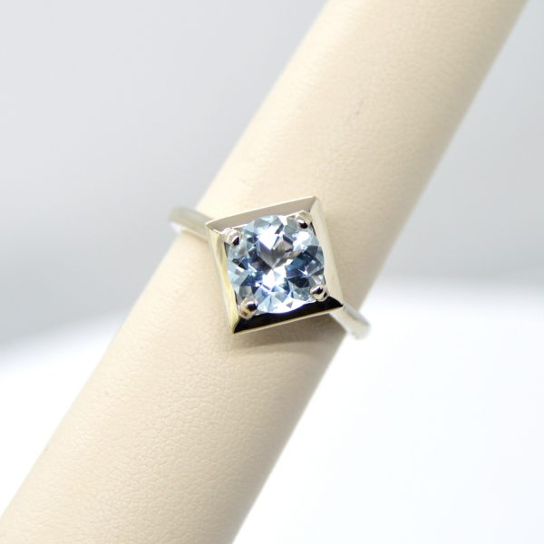 Aquamarine ring in 14K white gold in a geometric square setting
