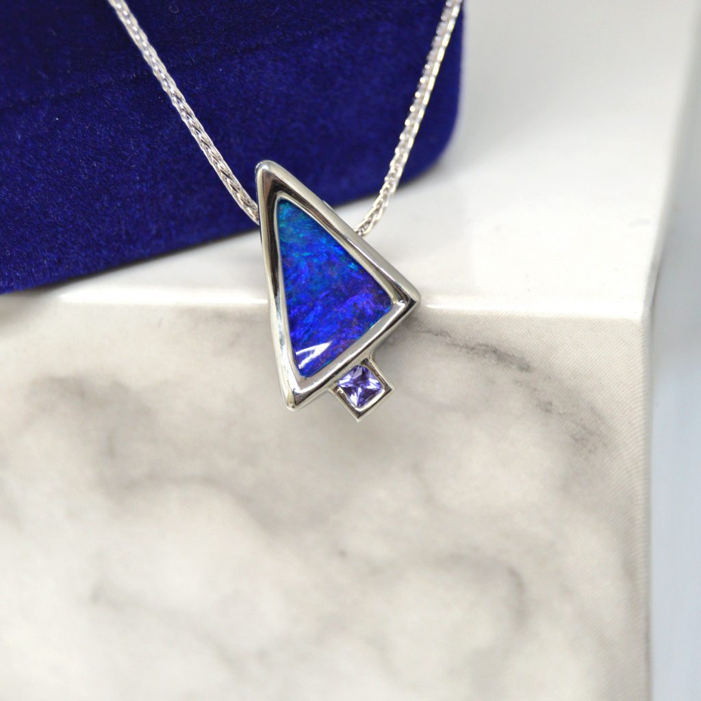 Australian Boulder Opal and Tanzanite necklace with bezel settings slide pendant on chain in 14K white gold. Designed by Morgan's Treasure