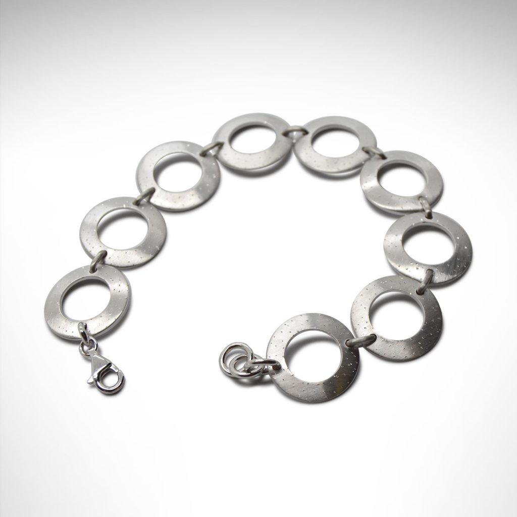 Sterling silver bracelet with circle links in a satin sparkle finish