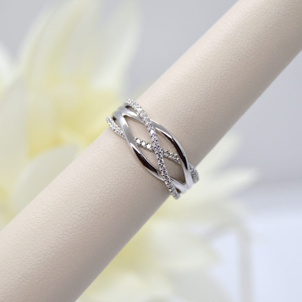 14K white gold criss cross organic freeform ring with diamonds designed by Allison Kaufman