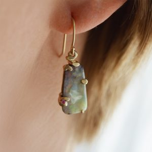 Australian boulder opal earrings set in 14Kt yellow gold brushed finish settings inspired by monet's water lilies with accents of ruby gemstones