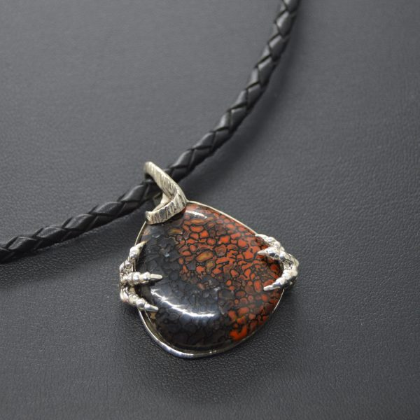 Dinosaur bone gemstone in sterling silver carved pendant on black braided leather cord, designed by Morgan's Treasure