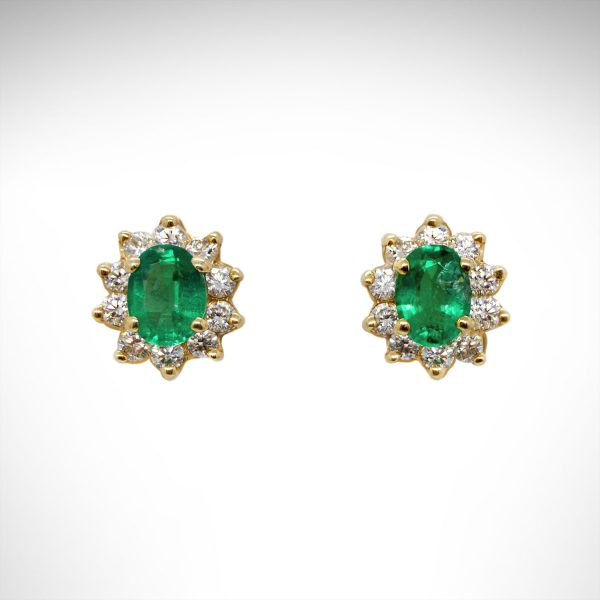 14K yellow gold earrings with oval emeralds and diamond halos.