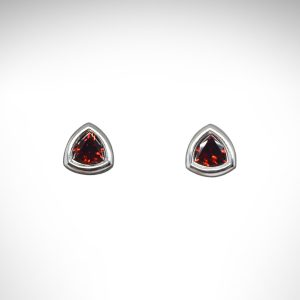 Trillion cut Mozambique red garnet gemstones in bezel stud earrings, 14Kt white gold