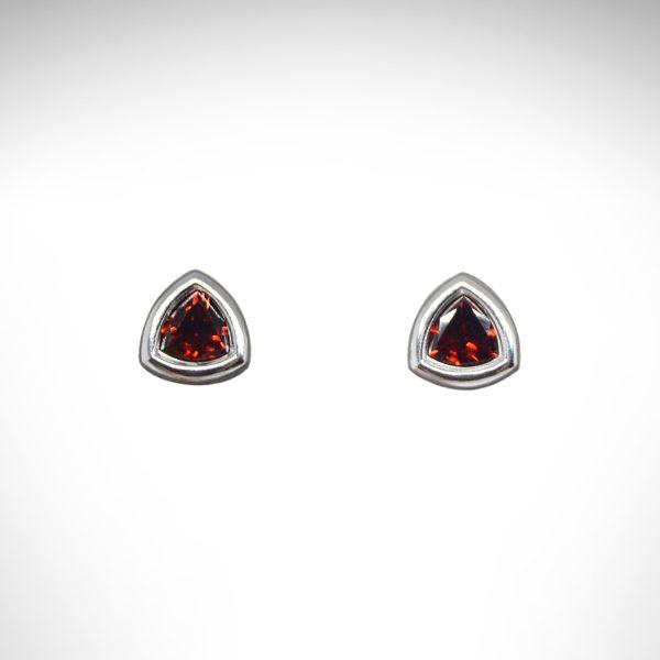 Trillion cut Mozambique red garnet gemstones in bezel stud earrings, 14Kt white gold