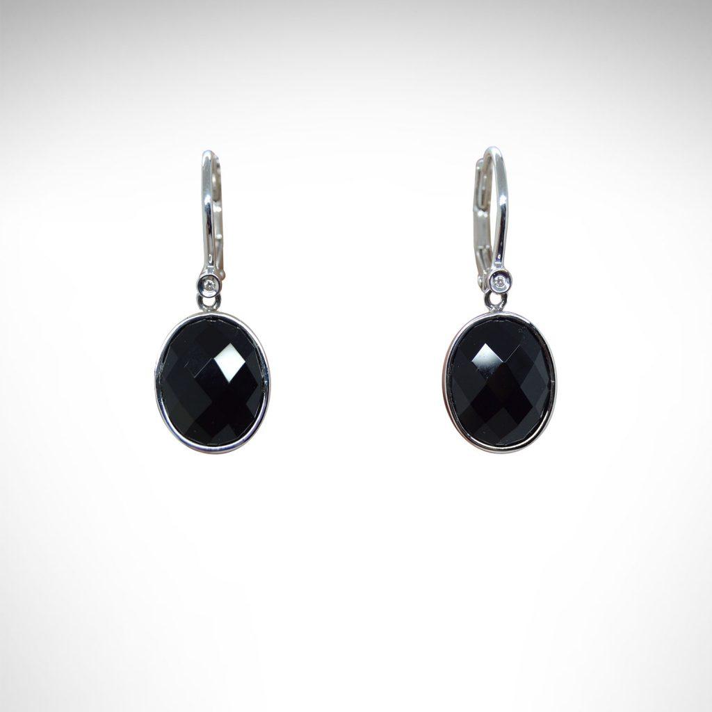 faceted onyx gemstones are bezel set as dangles from lever back earrings in 14k white gold