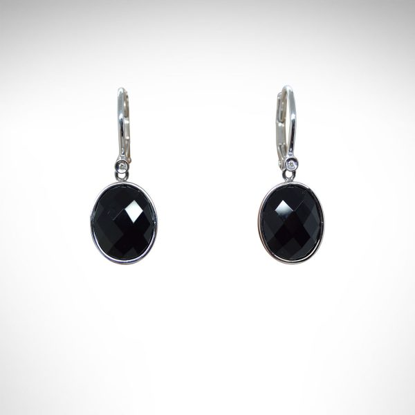 faceted onyx gemstones are bezel set as dangles from lever back earrings in 14k white gold