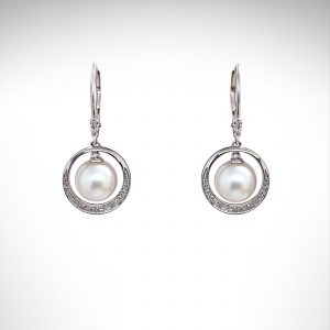 14K white gold earrings with white pearls dangling in a circle of pave set diamonds hanging from lever back ear wires.