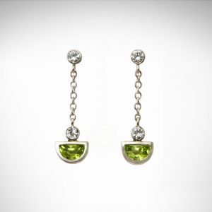 bezel-set peridot August birthstone cut in half moon shape with diamonds and chain as dangle post earrings in 14K white gold