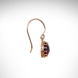 14K rose gold dangle earrings with crown style prongs set with cabochon rhodolite garnets