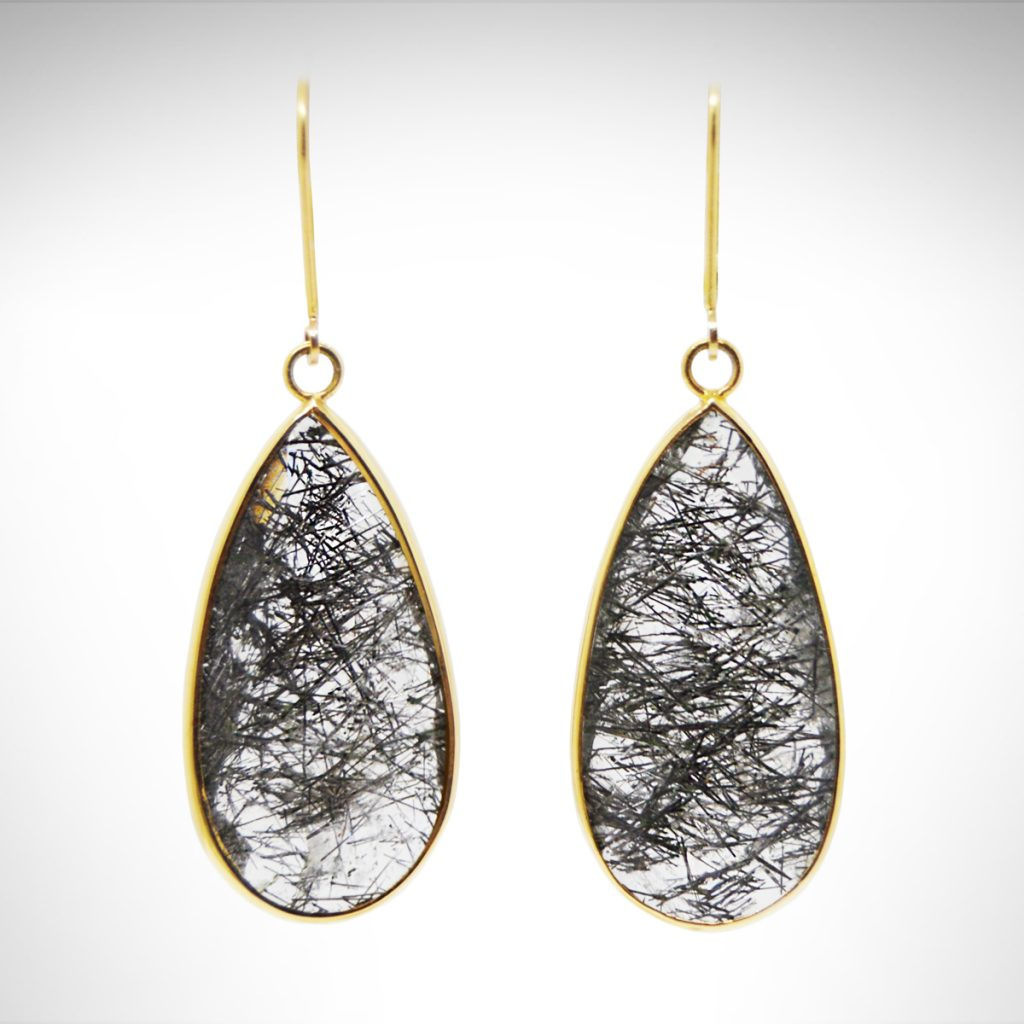 14k yellow bezel earrings dangle from lever-backs with faceted, translucent rutilated quartz gemstones in a teardrop shape.