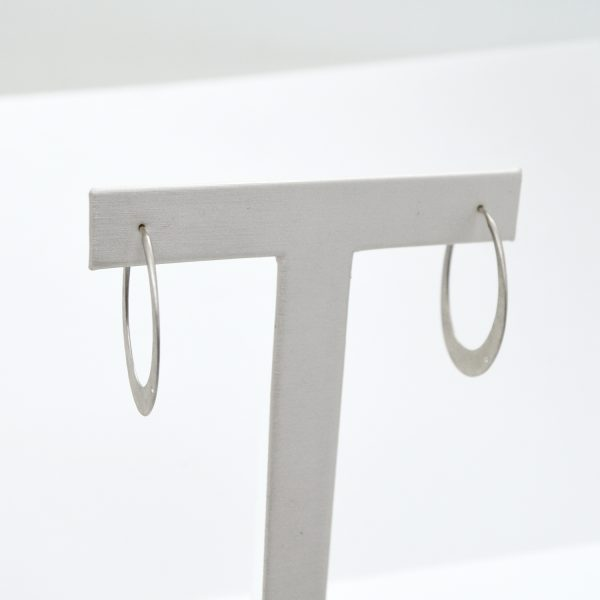 Hammered sterling silver hoop earrings with brushed finish and accent diamonds