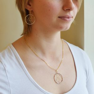 Dream catcher necklace in 14K white gold and 14k yellow gold, two-tone woven design with box chain.
