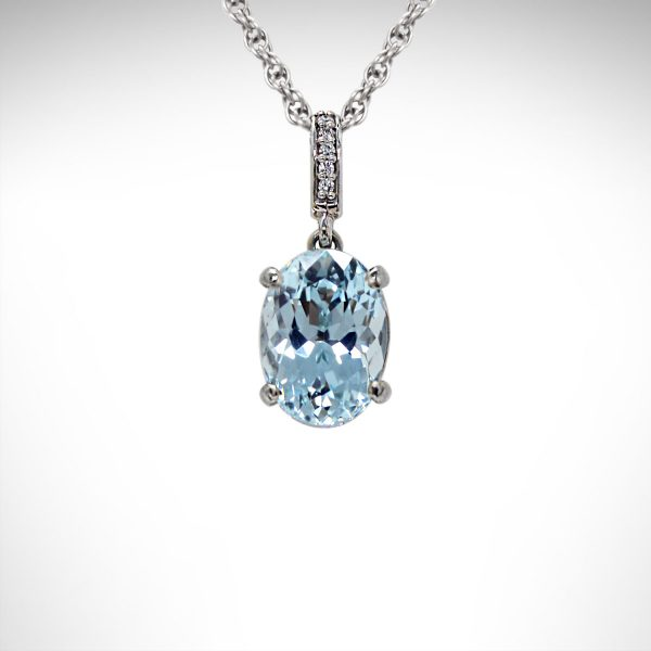 Aquamarine pendant in 14k white gold with diamonds in the bail on a chain