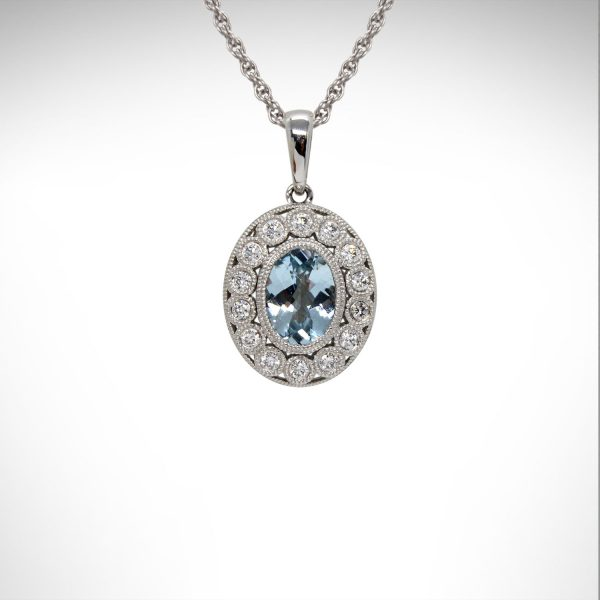 14K white gold necklace with aquamarine oval and filigree halo of diamonds