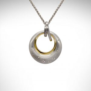 Breuning necklace in satin finish sterling silver with gold plate and white sapphires