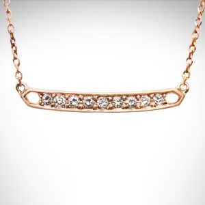 Rose gold bar necklace with pave set diamonds