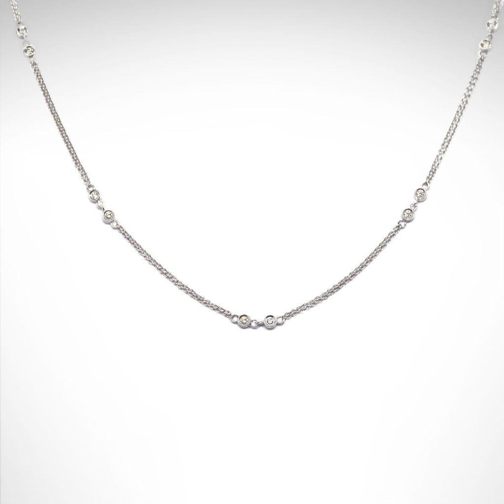 14k white gold necklace with double chain and dainty diamonds