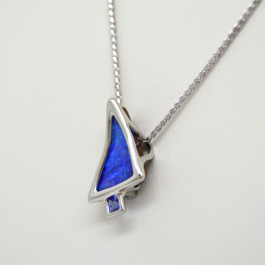designed by Morgan's Treasure, boulder opal and tanzanite necklace in white gold, triangular and square
