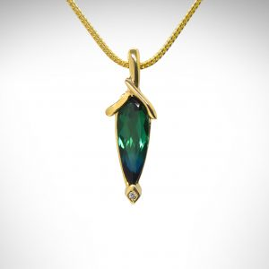bicolor green and blue tourmaline pear-cut gemstone in pendant with accent diamond in 14K yellow gold.