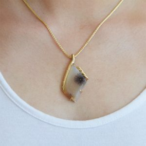 14K yellow necklace with dendritic druzy pendant, a natural agate gemstone with quartz crystals and dendrite inclusions in black and white with yellow gold design and accent diamonds flush set along side.