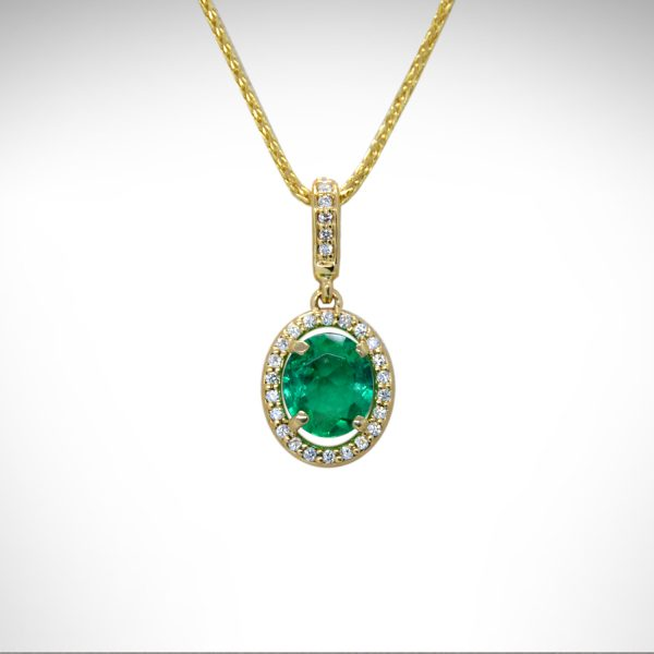 14ky gold emerald and diamond pendant with diamond halo and diamond bail on a yellow gold chain