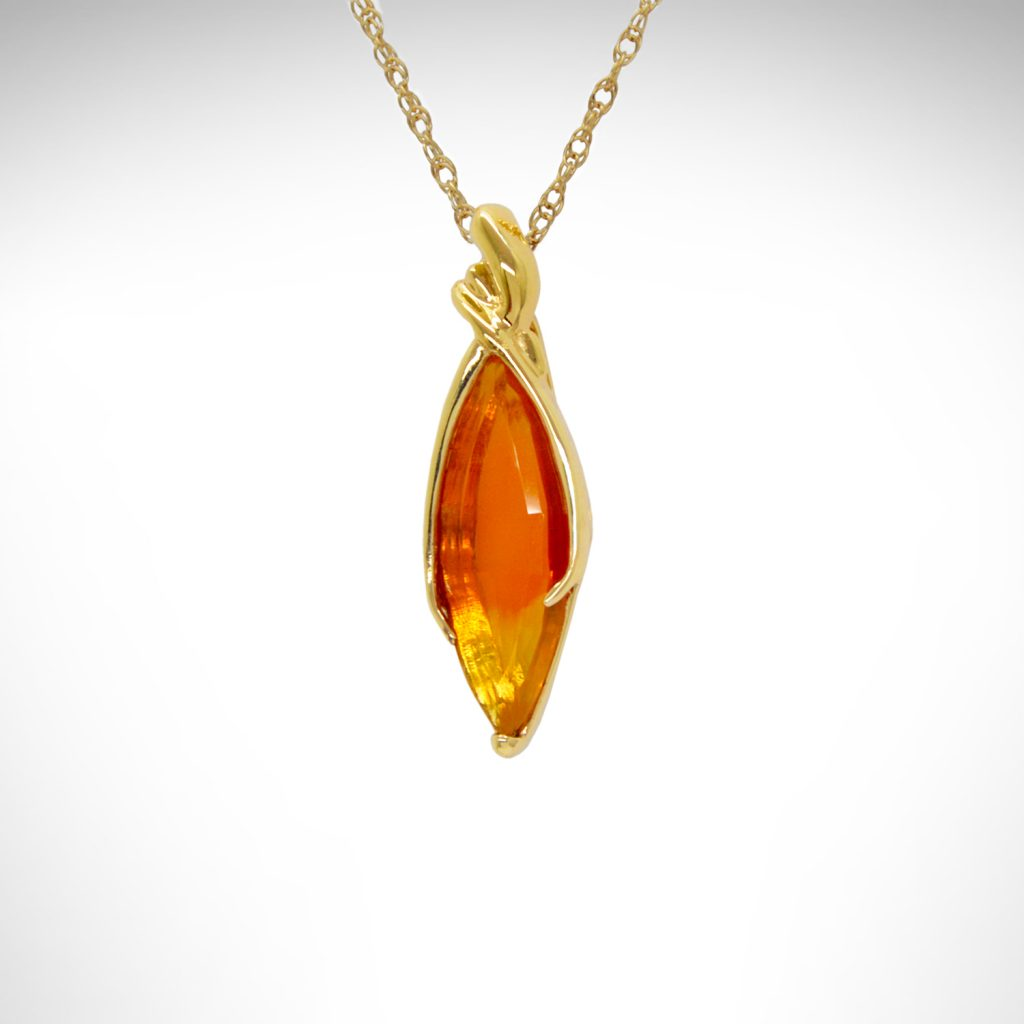 mexican fire opal gemstone, bicolor orange and yellow, pendant in yellow gold designed by Morgan's Treasure