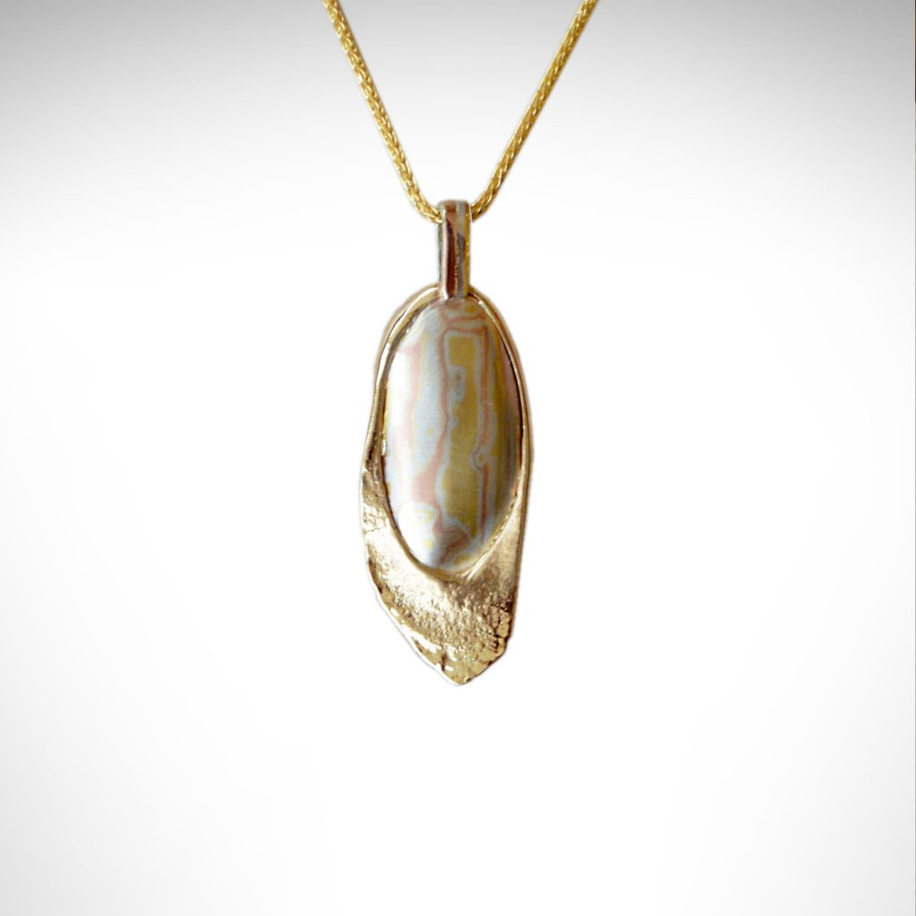 Designed by Morgan's Treasure, custom pendant with hand-fabricated mokume gane accent in 14K yellow gold pendant with chain