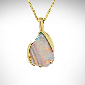 white opal custom designed necklace set in 14kt yellow gold