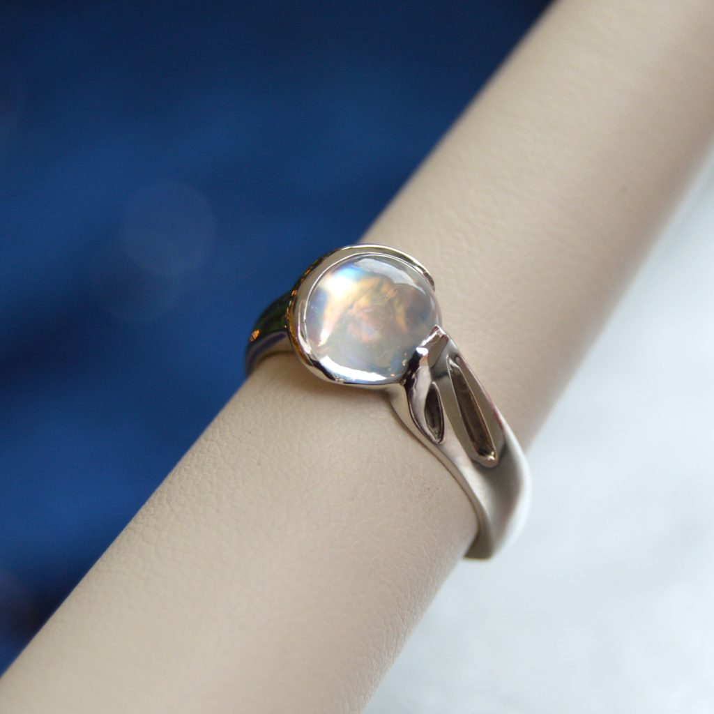 Designed by Morgan's Treasure, Rainbow Moonstone gemstone cabochon ring with crescent moon bezel, in white gold ring