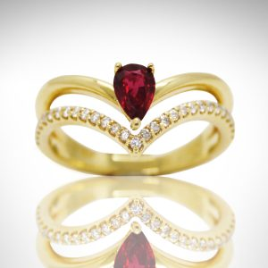14k yellow ring with pave diamonds and pear cut ruby