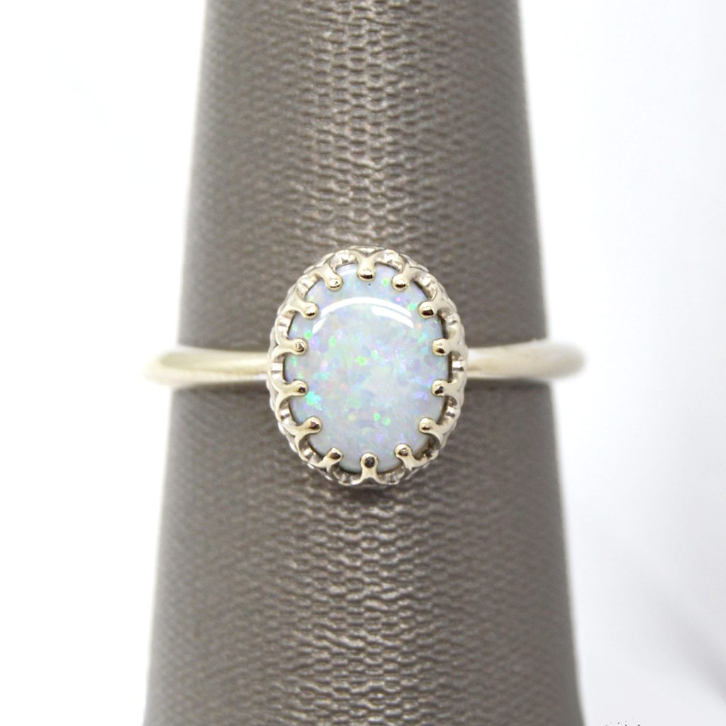 14K white gold ring with crown style prong setting and oval cabochon opal gemstone