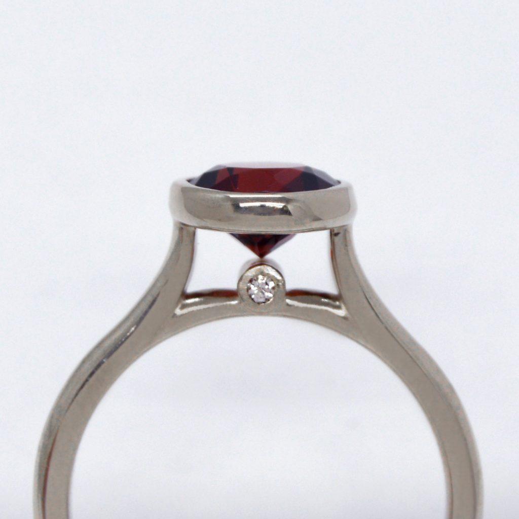 Round mozambique garnet in bezel set 14k white gold ring