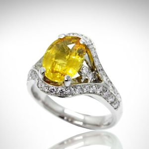 Oval yellow sapphire ring in white gold with pave set diamonds