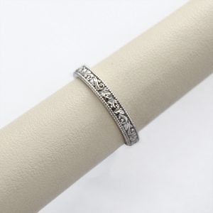 14k white gold band carved with vintage inspired design.
