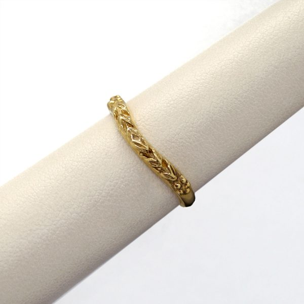 Carved 14KY gold band with curve to fit against engagement ring