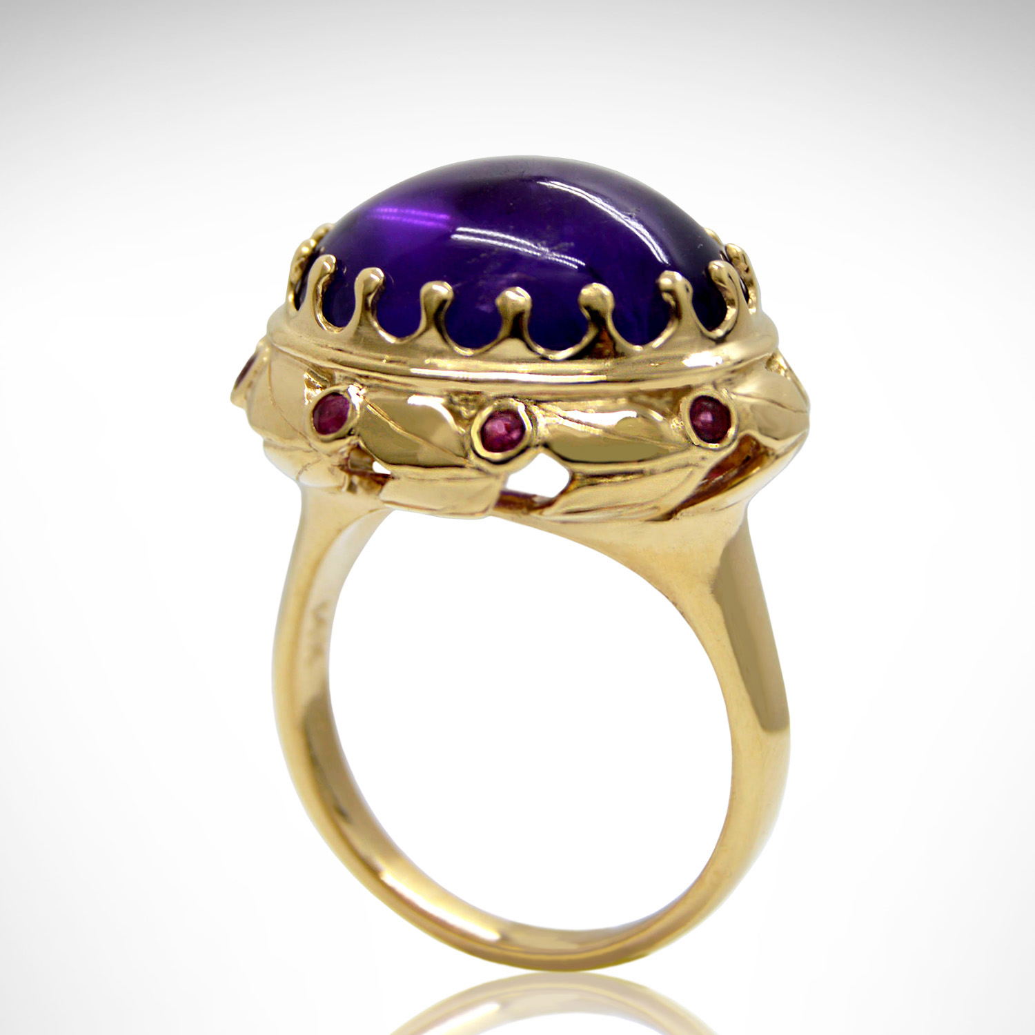 14k yellow gold ring with cabochon amethyst and rubies in an intricate leaf crown setting