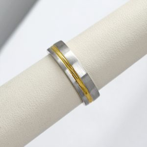 mens two-tone wedding band made with 14k white and yellow gold in an offset stripe pattern, a contemporary ring.