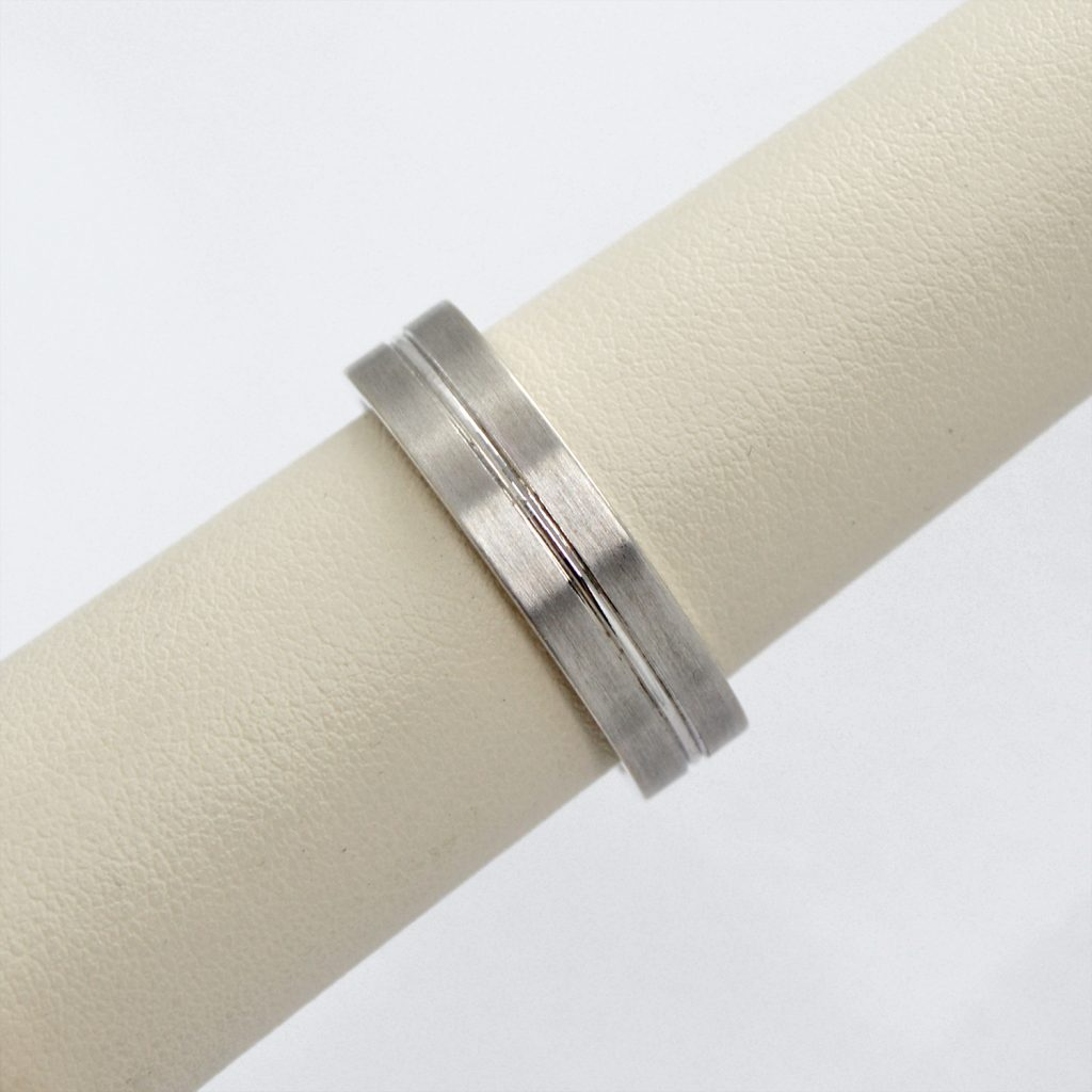 Mens wedding band in 14k white gold with brushed finish and polished carved linear design