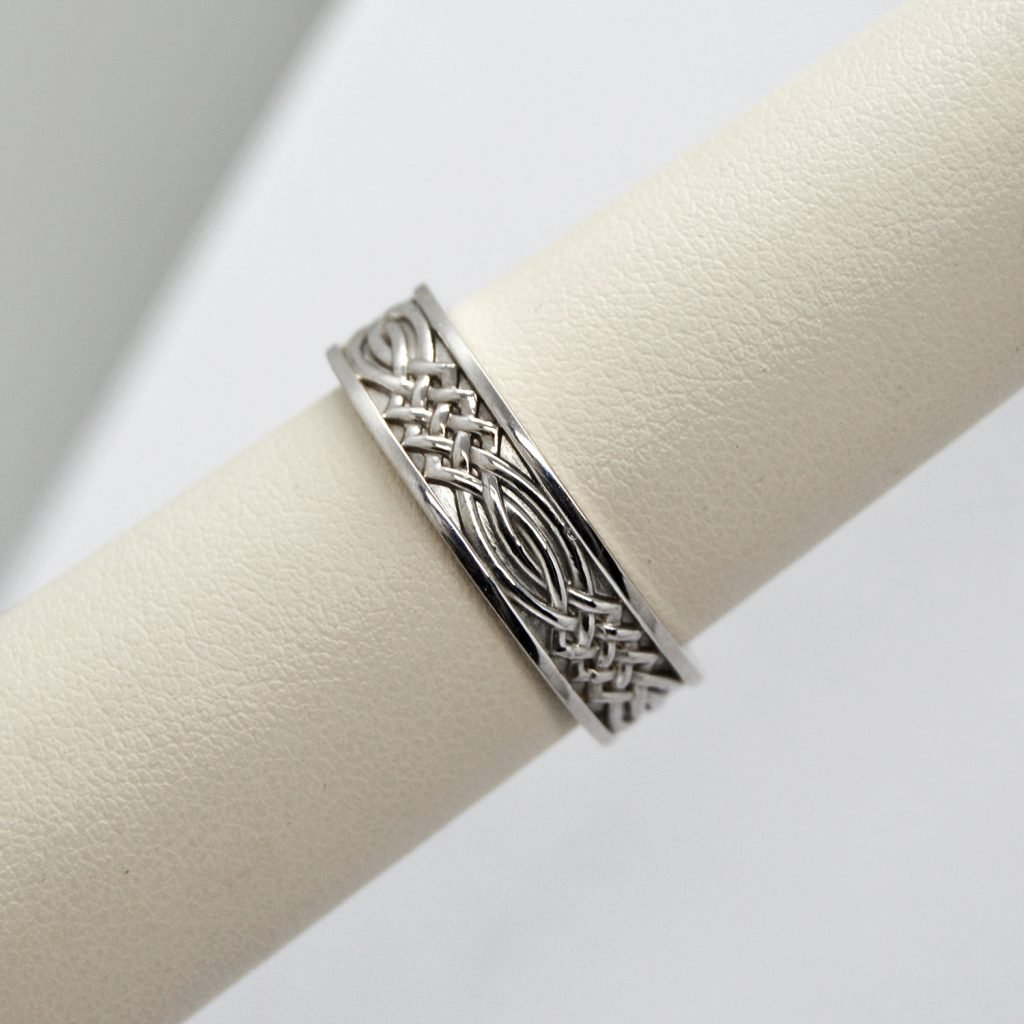 Celtic inspired mens wedding band in 14k white gold with knot design