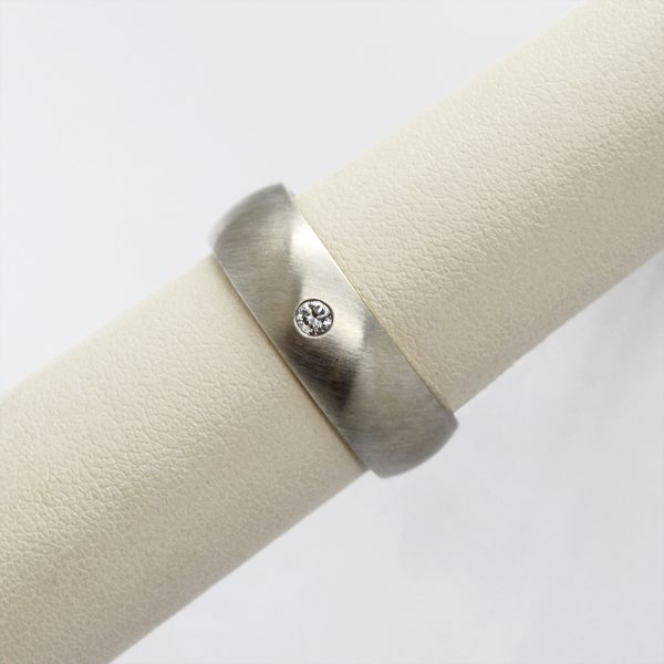 men's wedding band with half round shape and a single flush set accent diamond in 14k white gold.