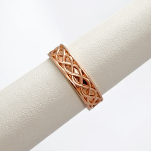 Celtic inspired mens wedding band in 14k rose gold with a braided design