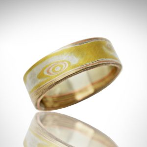 mokume gane ring with 18k yellow, 14k rose gold and sterling silver with wood-grain pattern
