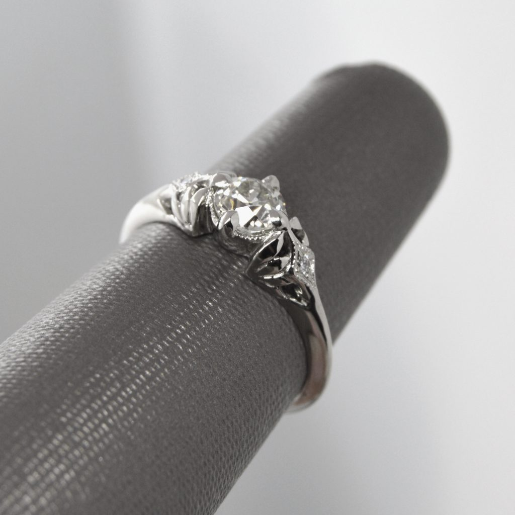 one of a kind engagement ring with old european cut diamond in 14k white gold with edwardian vintage inspired filigree setting and accent diamonds with millgrain detail
