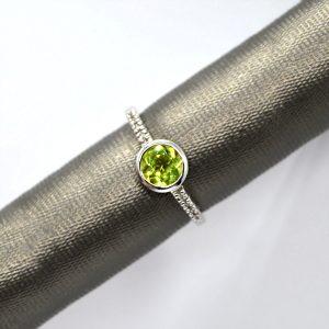 Bezel-set peridot and diamond ring in 14K white gold
