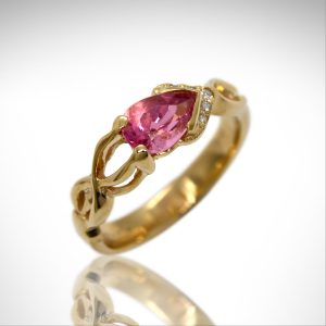 Pink tourmaline pear cut gemstone in 14K yellow gold ring custom designed with accent diamonds