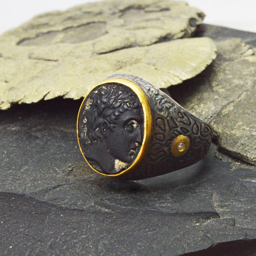 Carv ed onyx ring with intaglio portrait profile, oxidized sterling silver with an accent diamond and 24k gold